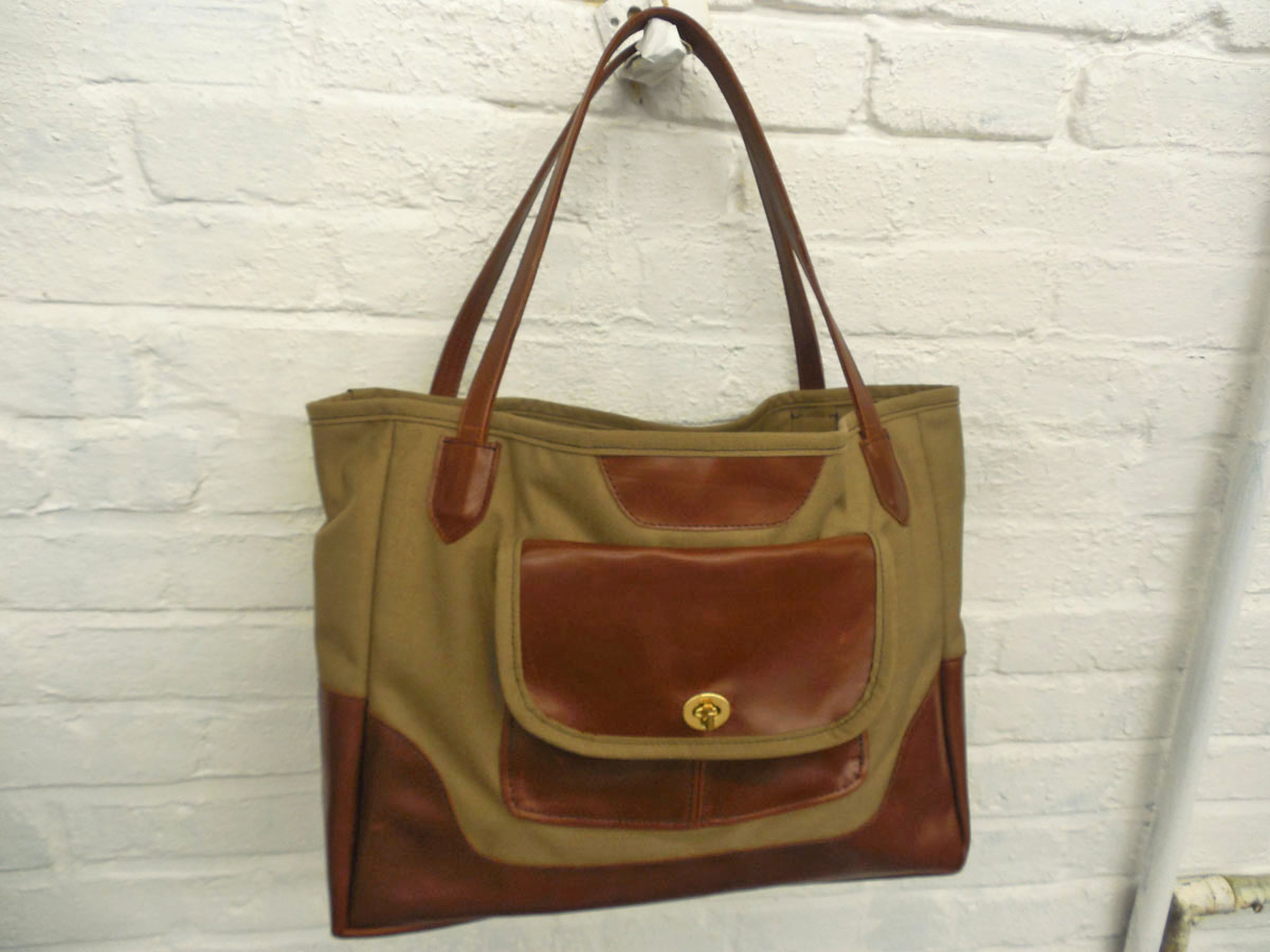 Tan And Brown Size 16 L X 13 H 4 D With 8 Strap Drop Pockets Glossy Leather Outside Pocket Has Fold Over Flap Clasp